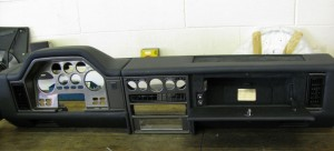 The original dashboard converted to LHD and retrimmed black.